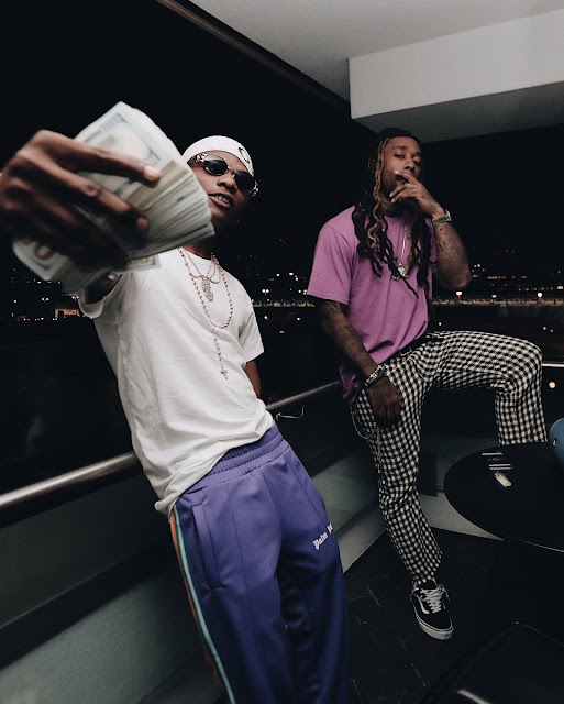 wp 1504692215316 - ENTERTAINMENT: Wizkid And American Singer, TY Dolla Sign In New Photo, Flaunts Dollar Bills