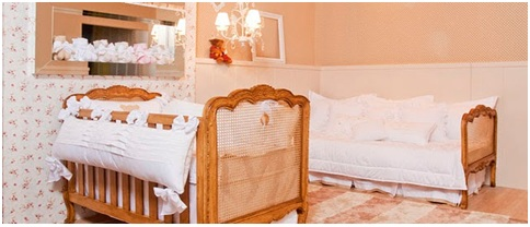 Old european style bedroom for babies with wooden furniture and high tech security systems