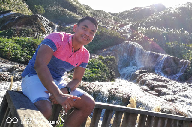 Mark Monta posing infront Golden Falls