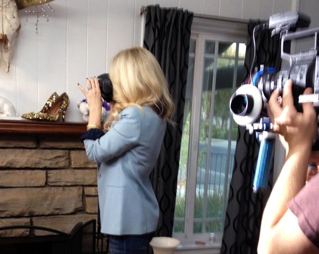 filming me take photos