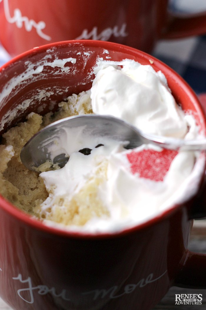 Digging into Vanilla Cake in a red Mug (for Two) with a spoon