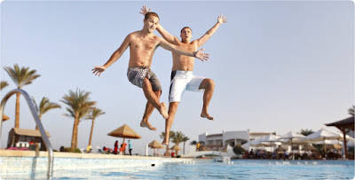 2 Guys from a stag do jumping in the pool