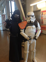 A person dressed up as a Stormtrooper and another person as Kylo Ren