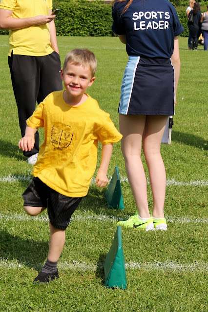 A boy taking part in a running race on sports day