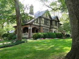 A beatiful image of a house taken from a garden