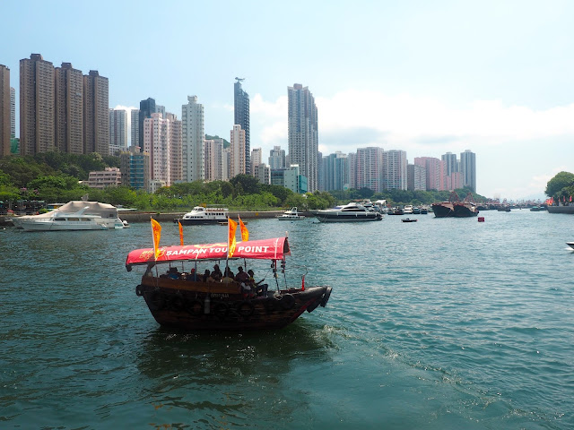 Sampan of tourists sailing through the harbour at Aberdeen, Hong Kong