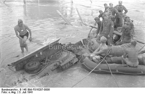 German soldiers recovering a fallen StuG III assault gun in the Pruth River 3 July 1941 worldwartwo.filminspector.com