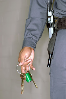 Correctional officer holding keys