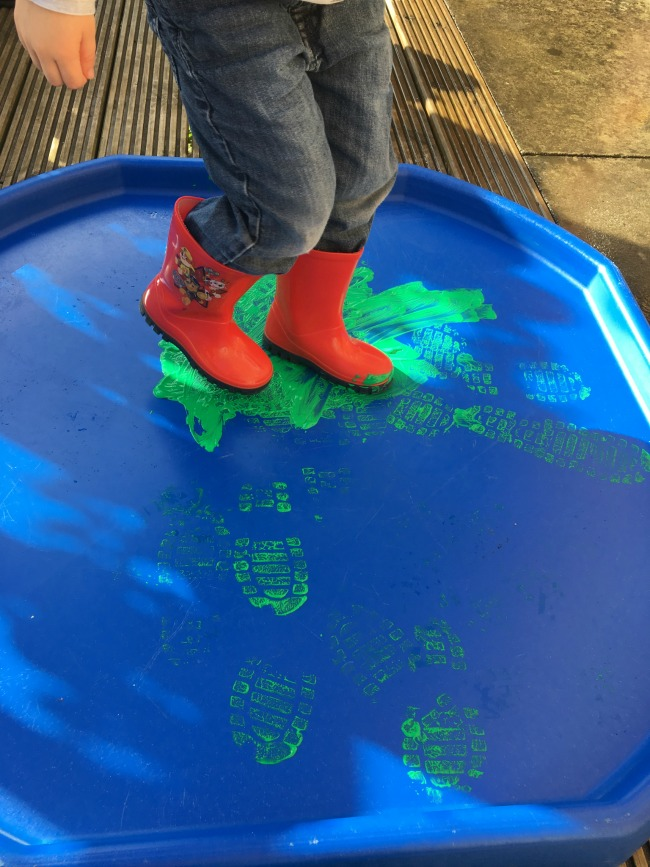 our-weekly-journal-Bear-in-his-wellies-standing-in-paint-on-a-tuff-tray