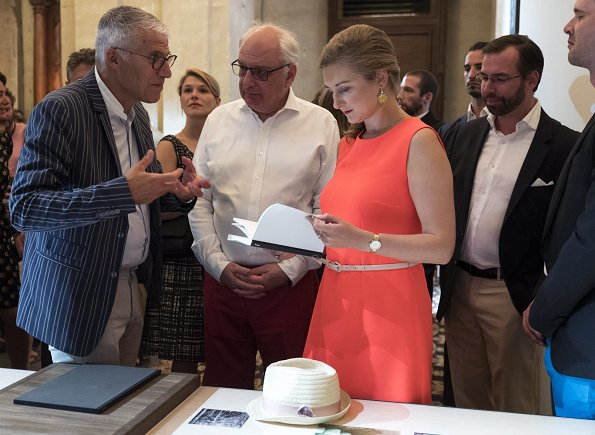 Hereditary Grand Duchess Stephanie wore a orange dress by Prada and Prada shoes at the opening of exhibition FLUX Feelings.