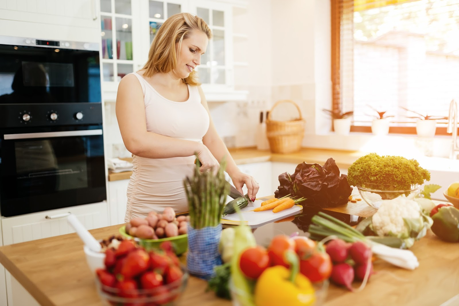 Pregnant woman preparing a healthy meal