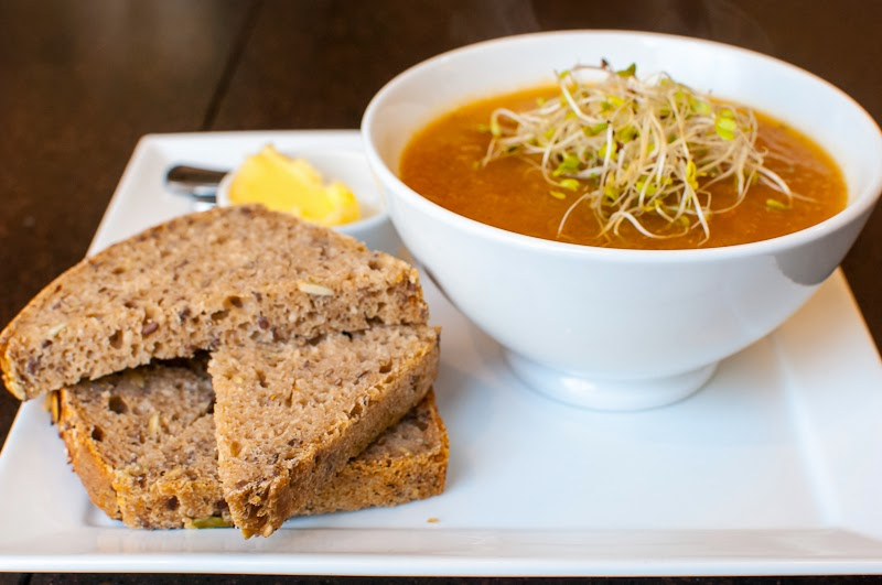pumpkin soup and seed bread in cafe