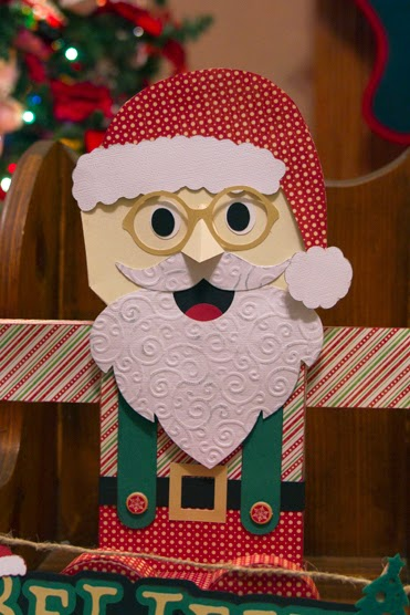 Close up of Santa's face showing a cheery smile and big eyes