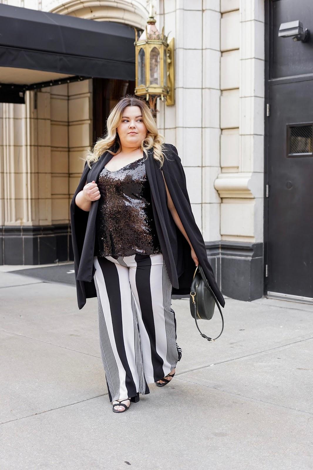 natalie Craig, natalie in the city, plus size fashion, Chicago fashion, plus size fashion blogger, eff your beauty standards, fatshion, skorch magazine, Chicago model, plus size model, plus size petite, affordable plus size clothing, embrace your curves, plus model magazine, striped pants, sequin top, plus size cape, fashion nova, forever 21 plus