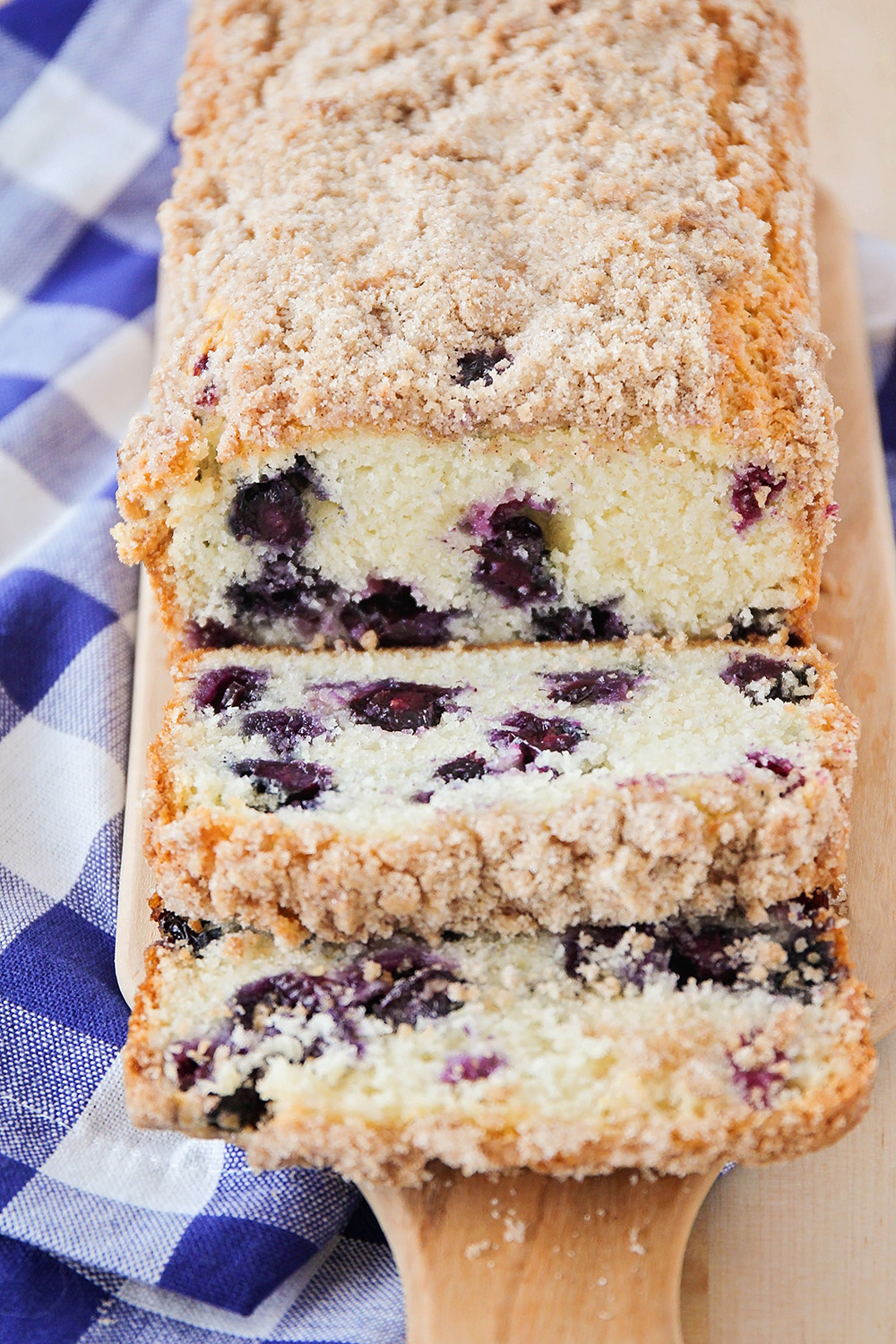 This blueberry muffin bread is so tender and sweet, and topped with a delicious buttery streusel. Perfect for breakfast or dessert!