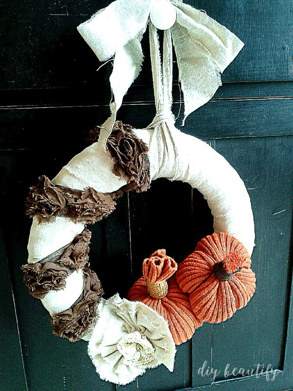 This shabby fall wreath is made ever better by the addition of diy sweater pumpkins! See more at diy beautify.