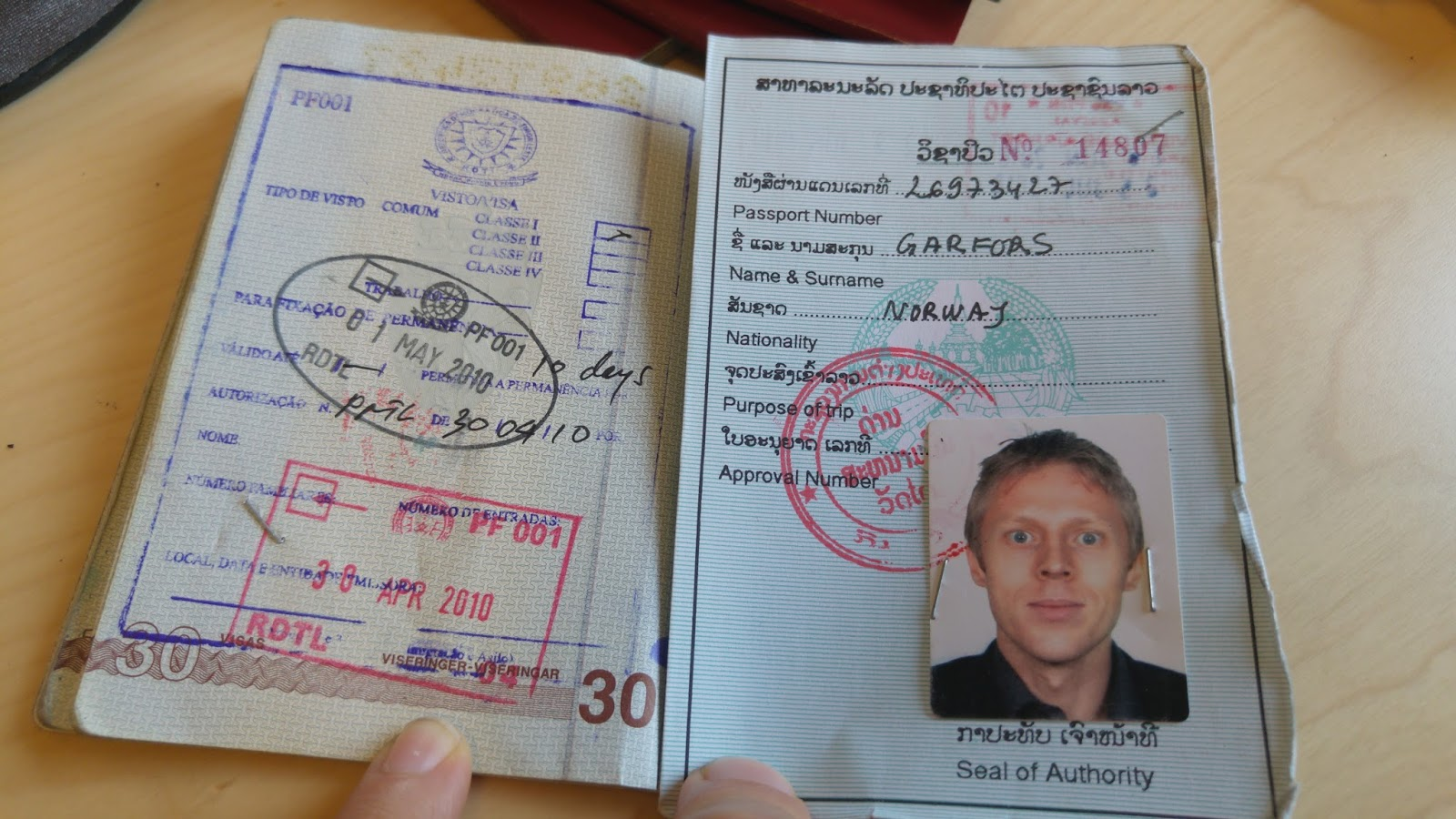 My Laos Passport Inside Norwegian One And A Form Of Stamp From EAST TIMOR 1 On The Left Never Mind Awful Photograph By Way