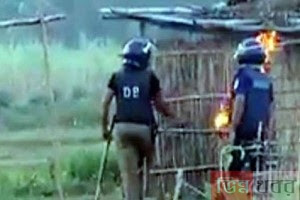 Two policemen identified Santal village fire