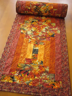 https://www.patchworkmountain.com/collections/table-runners/products/fall-table-runner-in-vibrant-colors