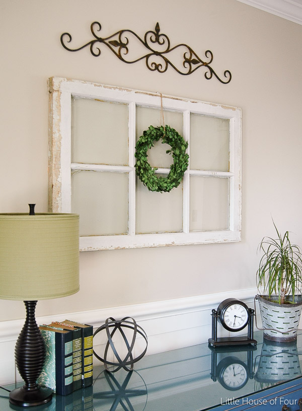 faux boxwood wreath over an old window