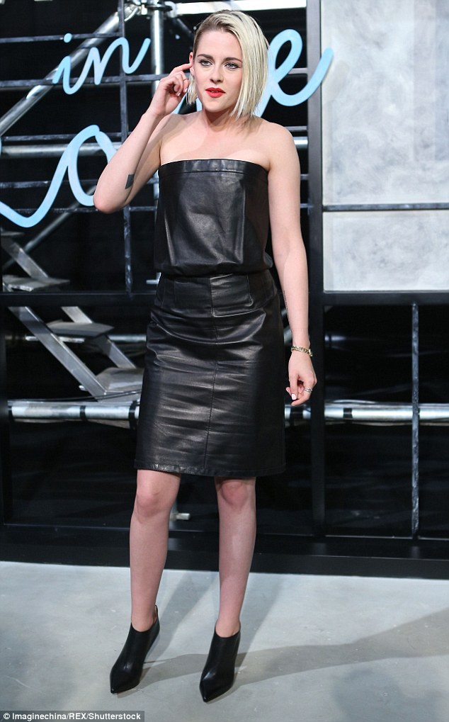 Kristen Stewart in sexy strapless black leather dress teamed with a bold red lip at Chanel event in Beijing