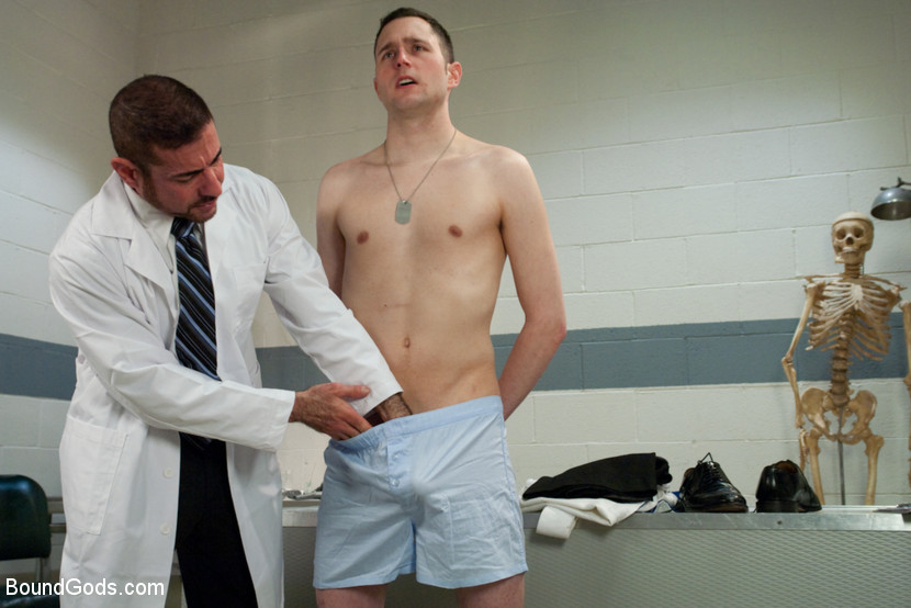 Gay businessman being examined by doctor