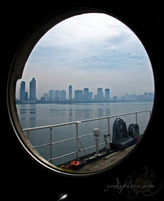 View of Manila from a cabin window on a ship at Manila Bay