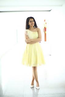 Rashi Khanna in a pale yellow shoulder less frock golden skin wow