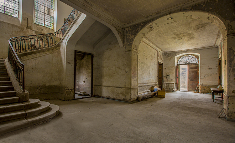 Foyer at Chateau de Gudanes with stone staircase