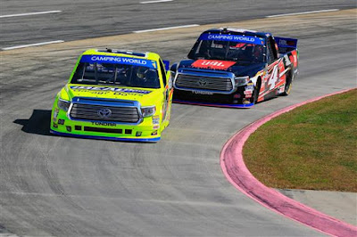 Matt Crafton, driver of the #88 Ideal Door/Menards Toyota,  leads Christopher Bell, driver of the #4 JBL Toyota, during practice.