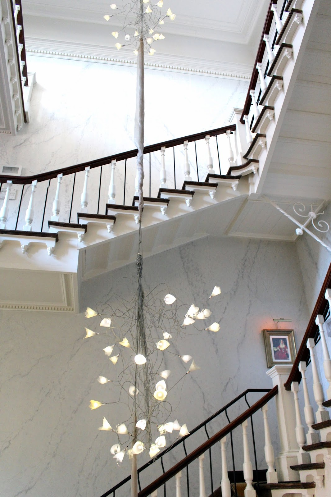 White winding staircase at hotel dukes' palace bruges