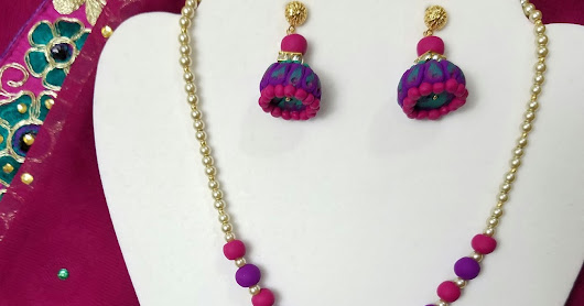 Hues of purple and green from Saree inspired the bright colored clay and pearl Jewelry set.