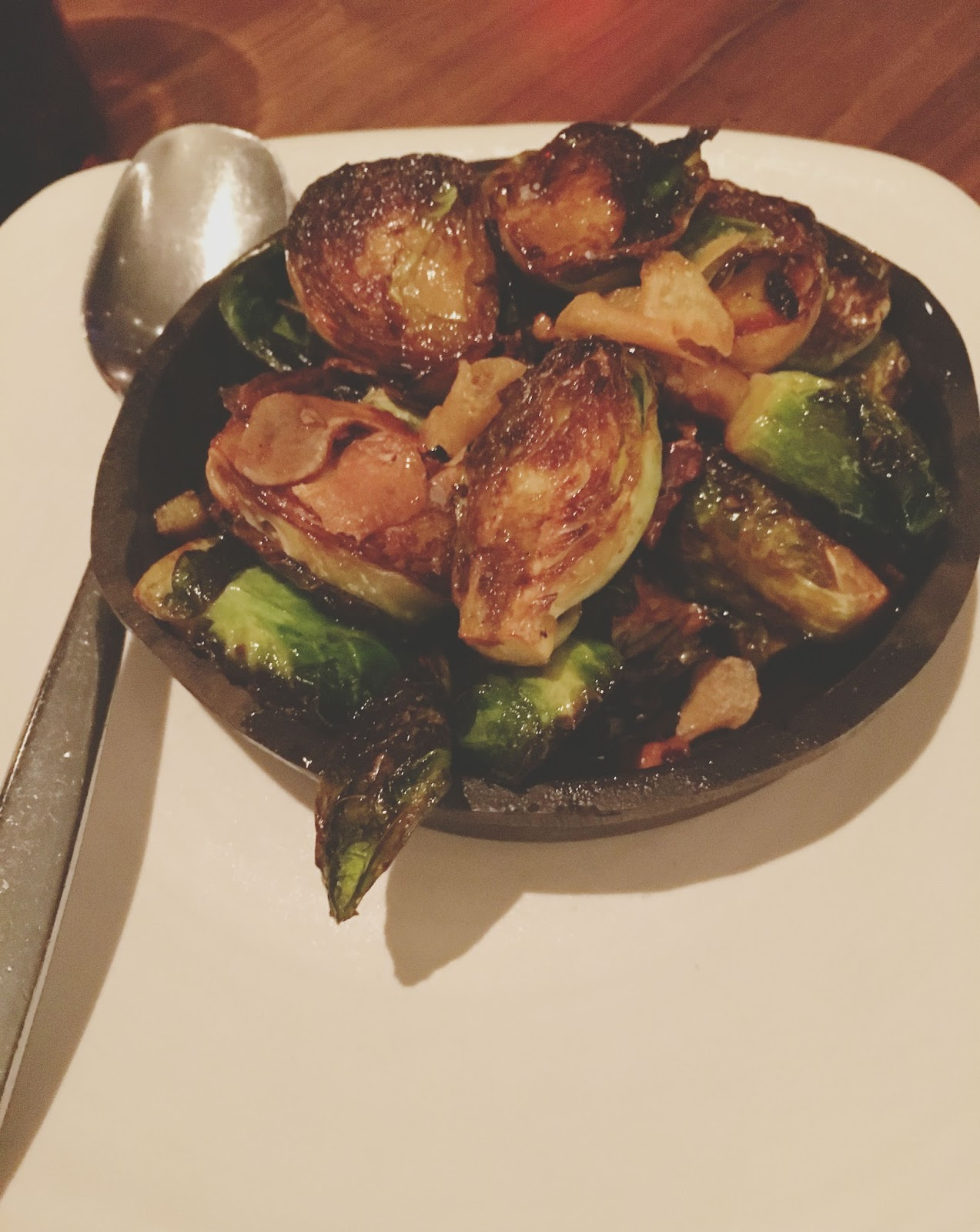 brussels sprouts at Oporto Fooding House & Wine - a restaurant in Houston, Texas