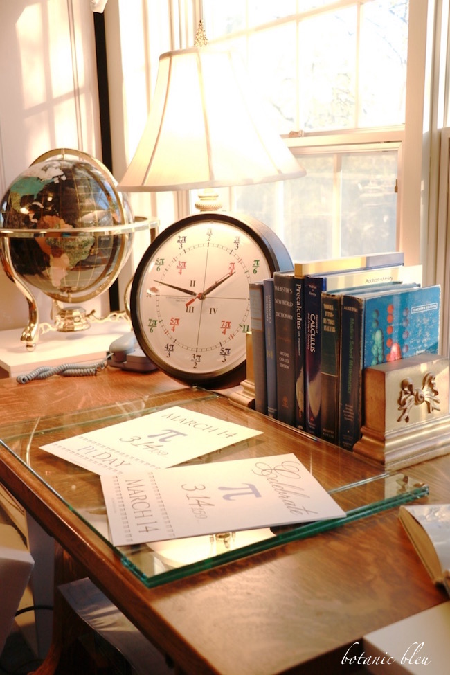 desk-with-radian-clock-old-math-textbooks
