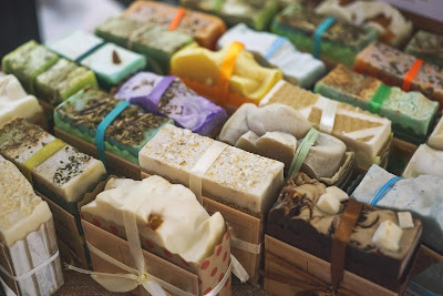 bars of colorful soap wrapped in a variety of ribbon and paper.