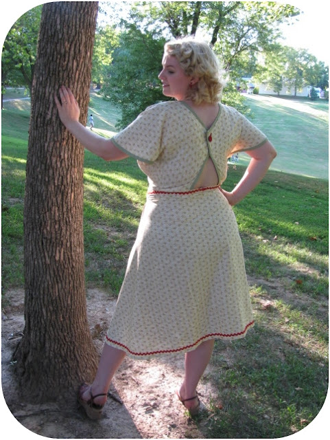 1940s marion martin 9377 plus size dress with back cut out and vintage pin curls