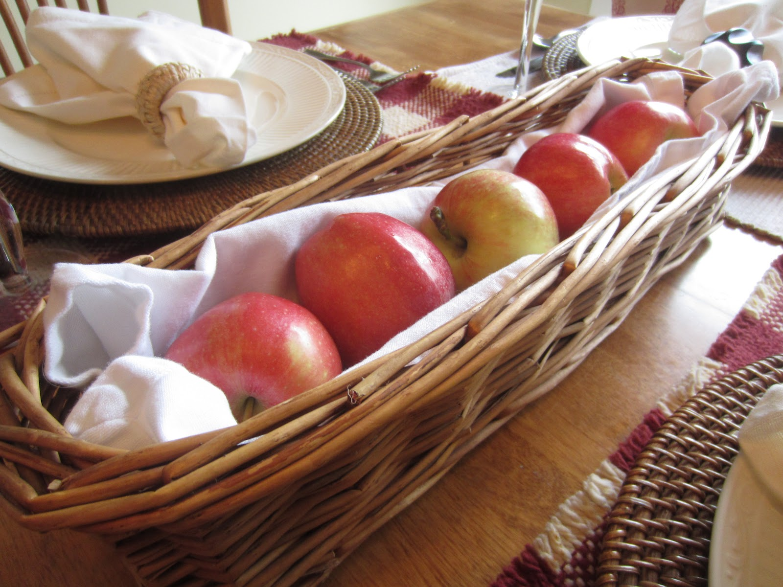 Fall Table Setting with Apples - Using seasonal fruits and colors to create a warm and inviting autumn table.