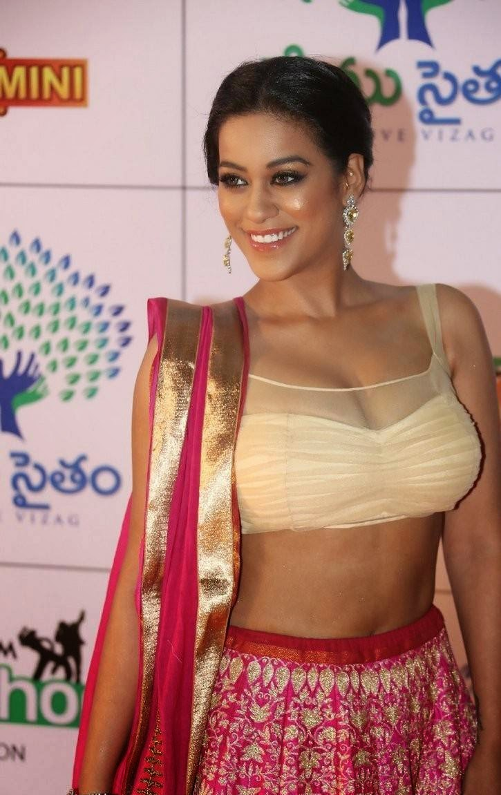 Mumaith Khan Photos, Mumaith Khan Slim Pics in Seyxy Lehenga Choli