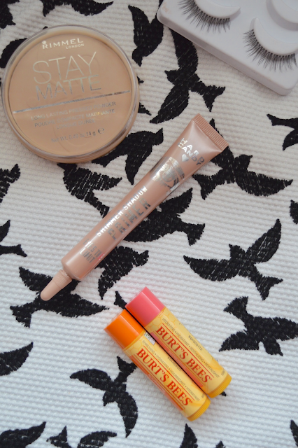 Rimmel Stay Matte Pressed Powder in Transparent, Ardell Natural Multipack in 110, Hard Candy Shimmer Eyeshadow Primer, Burt's Bees Refreshing Lip Balm, Burt's Bees Nourishing Lip Balm