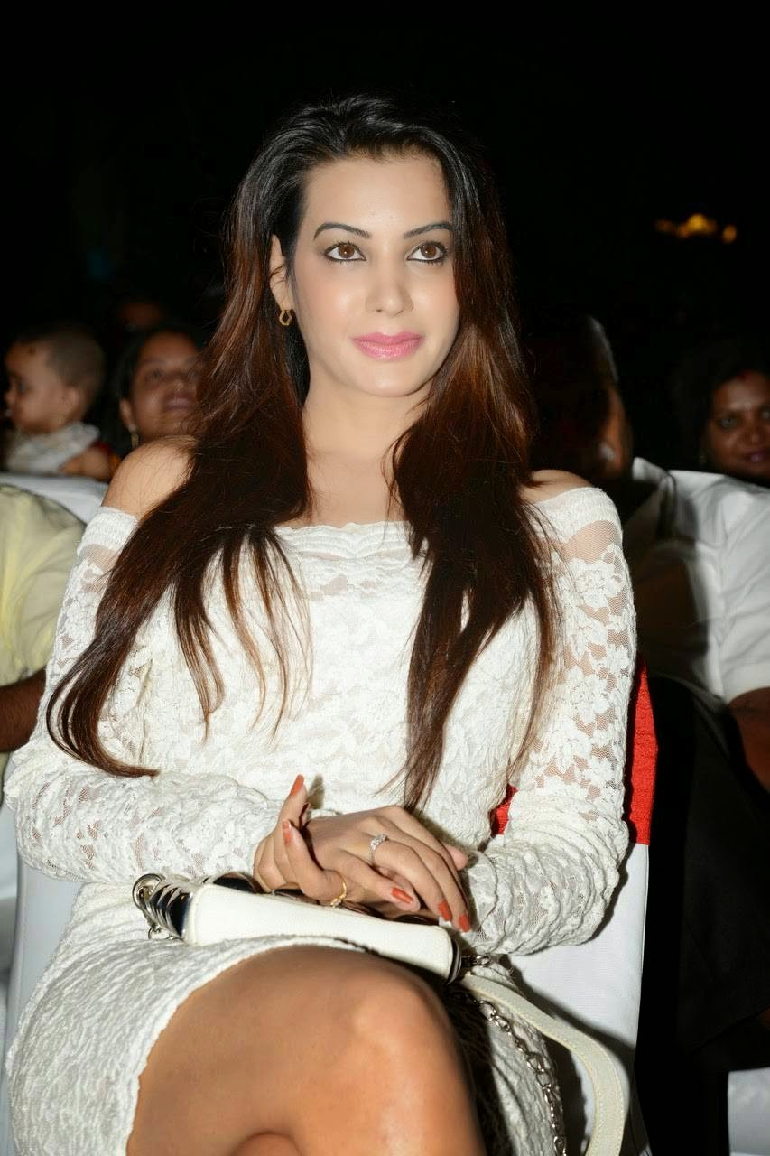 Diksha Panth Latest Photo Gallery, Actress Diksha Panth Crossleg Sitting Pics in White Dress from Event