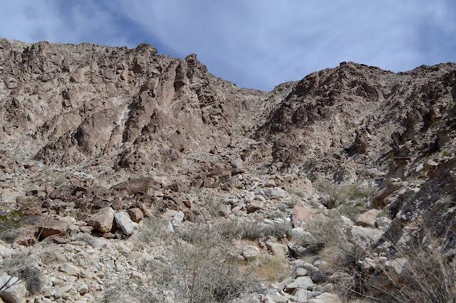 rocky chute between bedrock sticking up