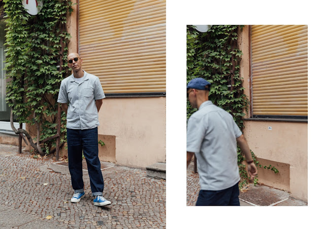 mat buckets wearing universal works denim trousers with jigsaw menswear resort collar shirt in berlin