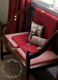 Settee with read and white checks