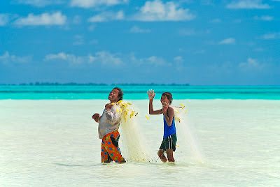 Father son carrying a fishing net, Biketawa - Kiribati