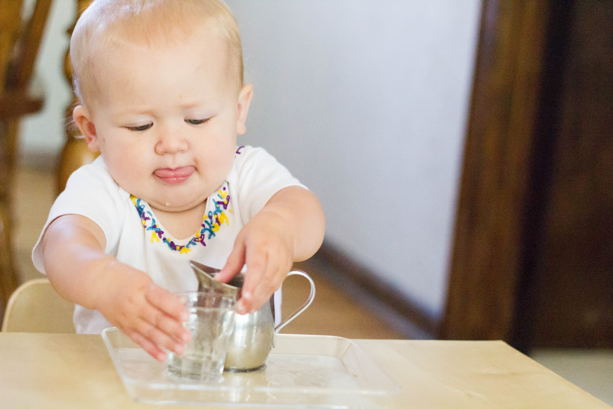 practical life toddler, Montessori, pouring