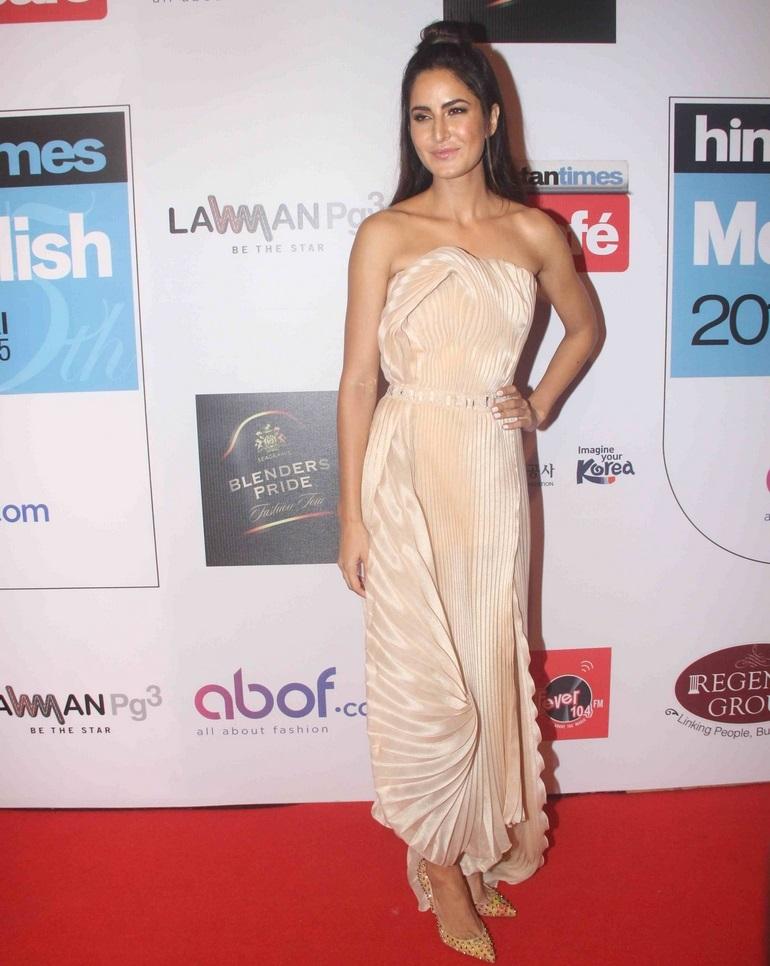 Bollywood Actress Katrina Kaif Hot Long Hair Sizzling Stills In Yellow Gown
