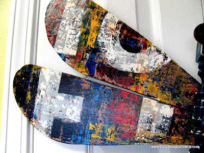 layered graffiti paint look for recycled dragonfly art