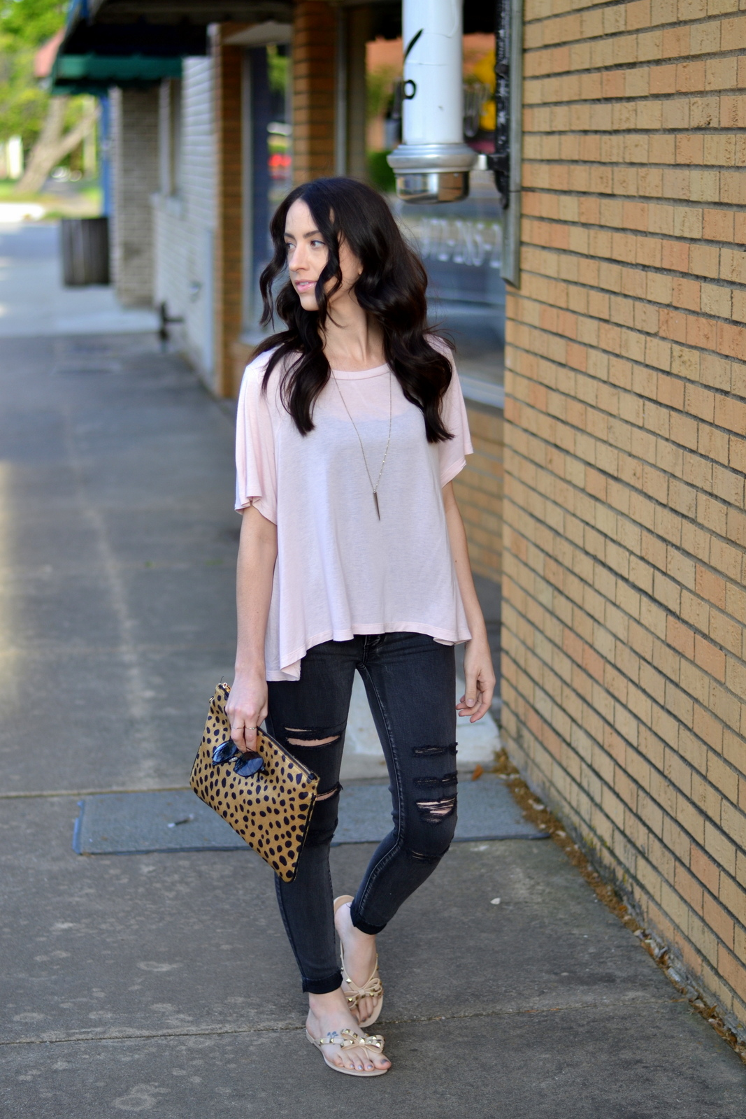 Dressing up a casual date night with leopard clutch and gold accessories