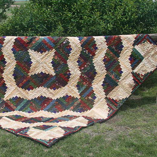 Curvy Log Cabin Quilt Free Pattern designed by Sharla of Thistle Thicket Studio