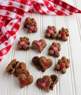 chocolate spritz cookies with chocolate ganache between them for Valentine's Day